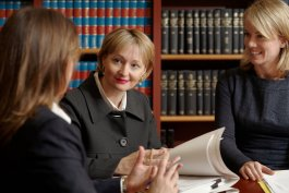 Tribunal member and staff reviewing a file
